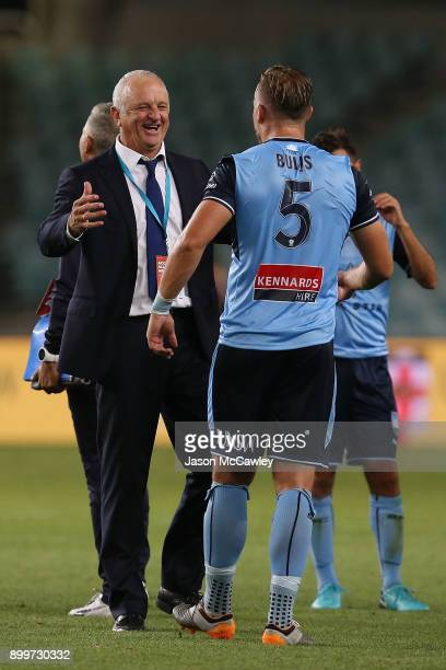 Graham Arnold head coach of Sydney celebrates victory with Jordy Buijs at the end of the round 13 ALeague match between Sydney FC and Perth Glory at...