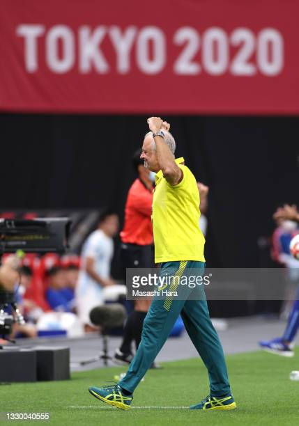 Graham Arnold, Head Coach of Team Australia celebrates after victory in the Men's First Round Group C match between Argentina and Australia during...