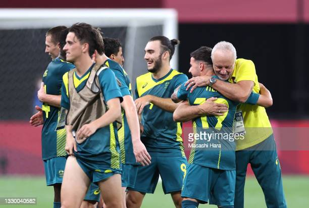 Graham Arnold, Head Coach of Team Australia celebrates with Marco Tilio after victory in the Men's First Round Group C match between Argentina and...