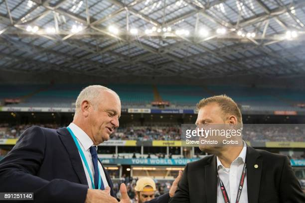 Graham Arnold of Sydney FC talks to Wanderers Josep Gombau before kick off in the round ten ALeague match between the Western Sydney Wanderers and...