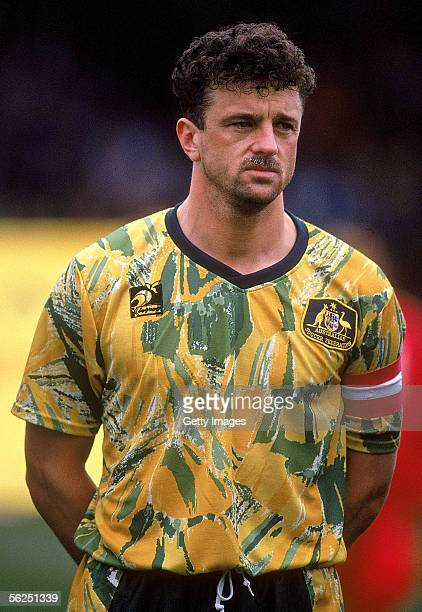 Graham Arnold of the Socceroos looks on during the singing of the National Anthem before the start of the World Cup qualifying match between...