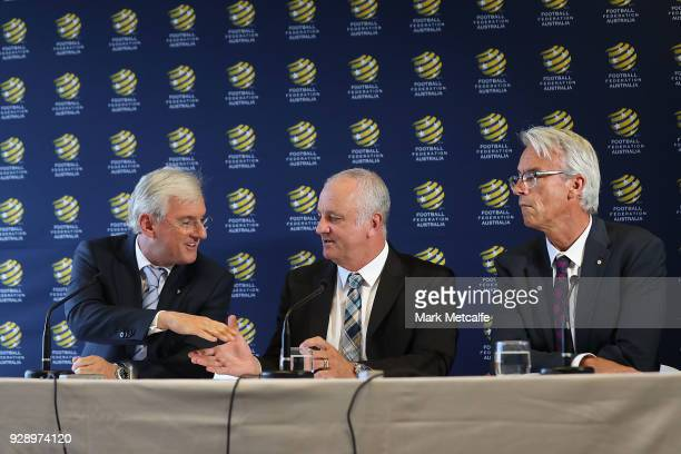 Graham Arnold shakes hands with FFA chairman Steven Lowy during a press conference announcing the succession plan for long term appointment of head...