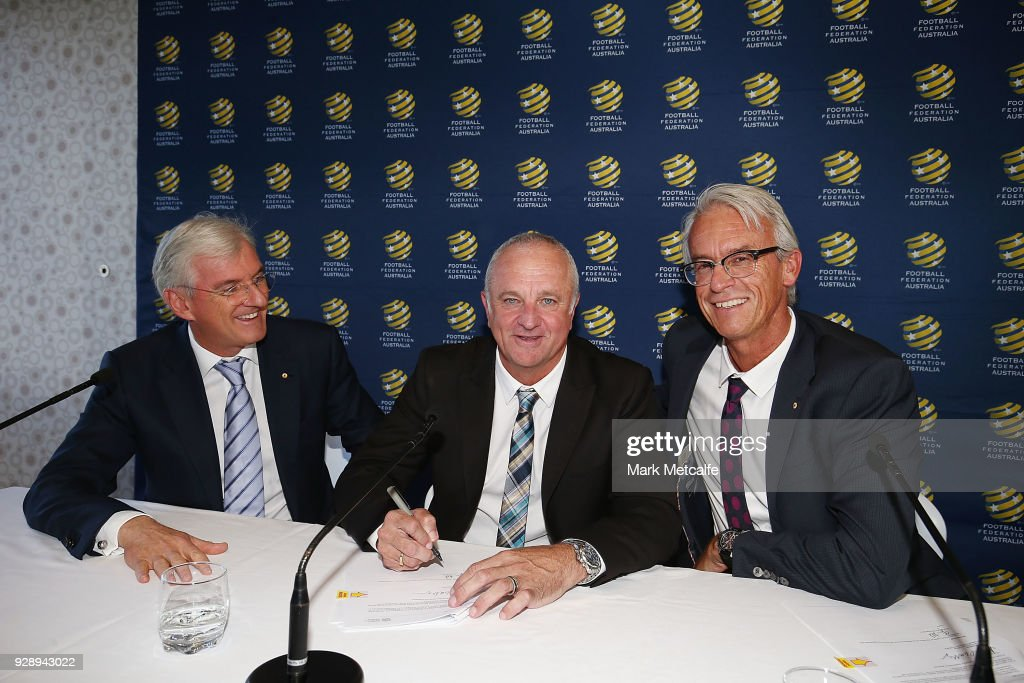 Graham Arnold signs a contract alongside FFA Chairman Steven Lowy and FFA CEO David Gallop during a press conference announcing the succession plan for long term appointment of head Socceroos coach, at FFA Headquarters on March 8, 2018 in Sydney, Australia.