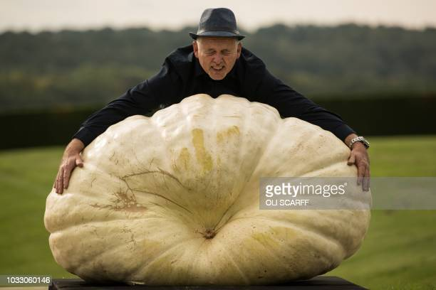 TOPSHOT Graham Barrat poses for a photograph with his 3198 kg pumpkin which won the the heaviest pumpkin competition on the first day of the...