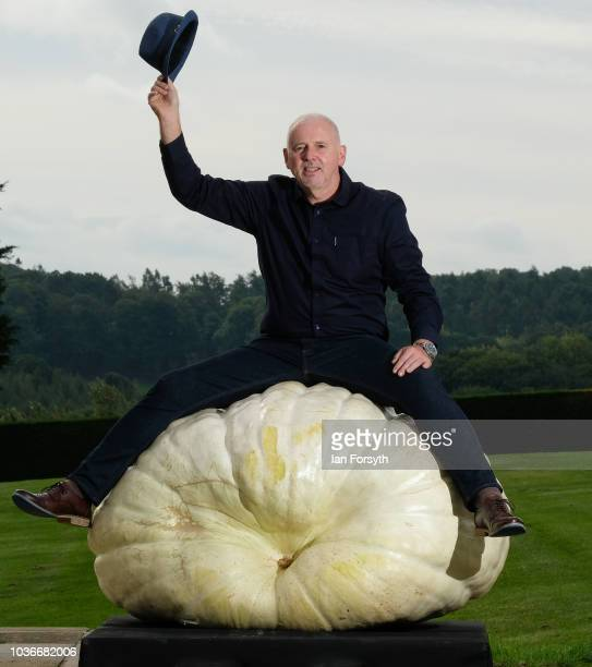 Graham Barratt from Gloucester poses for a media call with his winning pumpkin which won with a weight of 3198kg after judging takes place for the...