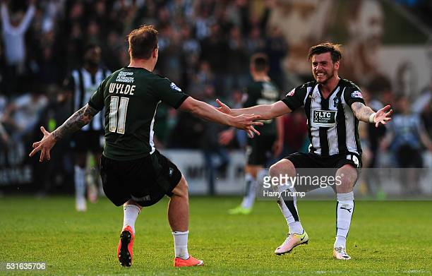 Graham Carey of Plymouth Argyle celebrates with Gregg Wylde of Plymouth Argyle at the final whistle during the Sky Bet League Two Play Offs Second...