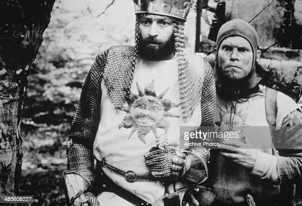 Graham Chapman , as King Arthur, with Terry Gilliam as his sidekick, in a scene from 'Monthy Python and the Holy Grail', directed by Terry Gilliam...