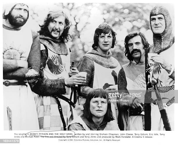 Graham Chapman Eric Idle Terry Gilliam Michael Palin Terry Jones and John Cleese standing together in a scene from the film 'Monty Python And The...