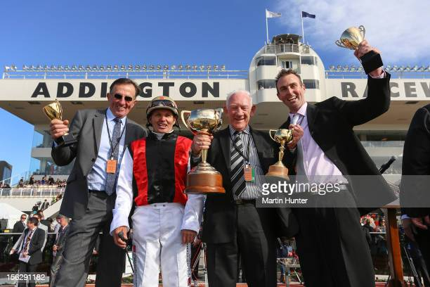 Graham Court Ricky May Terry McDonald and Paul Court celebrate with their trophies after their horse Terror To Love won the NZ Trotting Cup during...