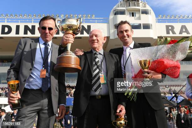 Graham Court Terry McDonald and Paul Court celebrate with their trophies after their horse Terror To Love won the NZ Trotting Cup during the NZ...