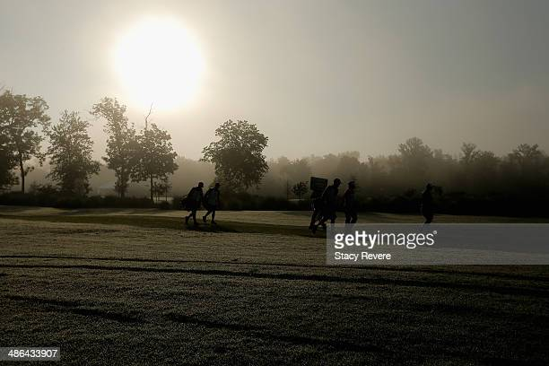Graham Delaet and his group walk up the 1st fairway during Round One of the Zurich Classic of New Orleans at TPC Louisiana on April 24 2014 in...