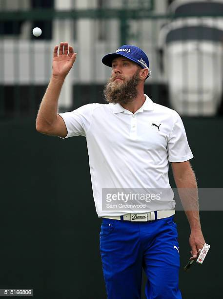 Graham DeLaet of Canada catches his ball on the 17th green during the third round of the Valspar Championship at Innisbrook Resort Copperhead Course...