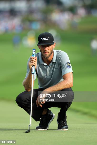 Graham DeLaet of Canada lines up a putt during the final round of the 2017 PGA Championship at Quail Hollow Club on August 13 2017 in Charlotte North...