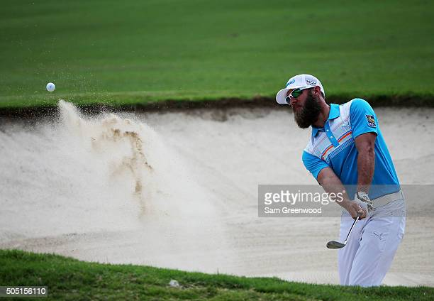 Graham DeLaet of Canada plays a shot from a bunker on the tenth hole during the second round of the Sony Open In Hawaii at Waialae Country Club on...