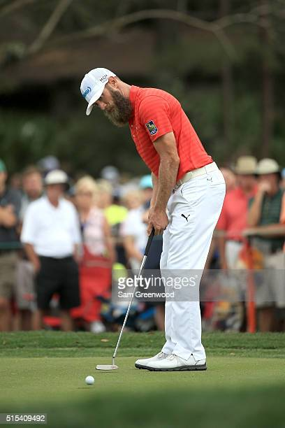 Graham DeLaet of Canada putts on the fourth green during the final round of the Valspar Championship at Innisbrook Resort Copperhead Course on March...