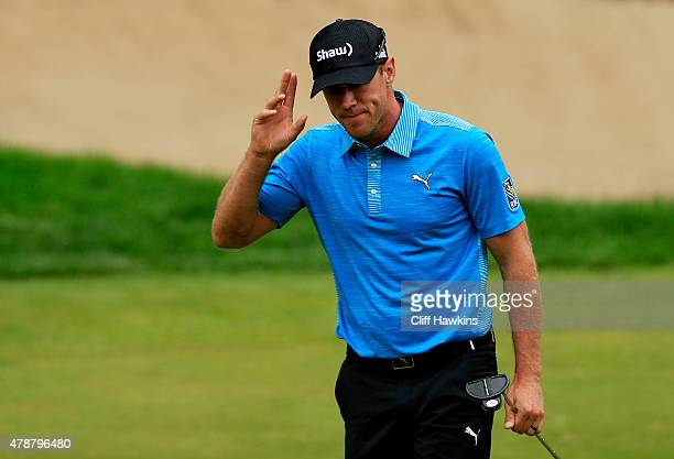 Graham DeLaet of Canada reacts after finishing on the 18th green during the third round of the Travelers Championship at TPC River Highlands on June...