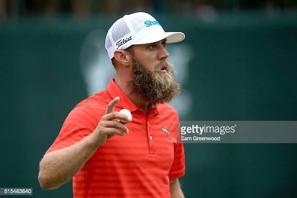 Graham DeLaet of Canada reacts after his putt on the 18th green during the final round of the Valspar Championship at Innisbrook Resort Copperhead...