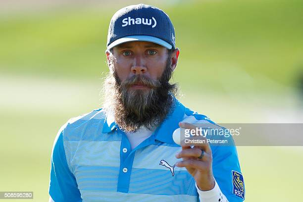 Graham DeLaet of Canada reacts to a putt on the seventh hole during the second round of the Waste Management Phoenix Open at TPC Scottsdale on...