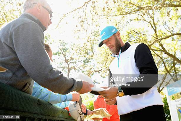Graham DeLaet of Canada signs autographs during the first round of the Valspar Championsihp at Innisbrook Resort and Golf Club on March 13 2014 in...