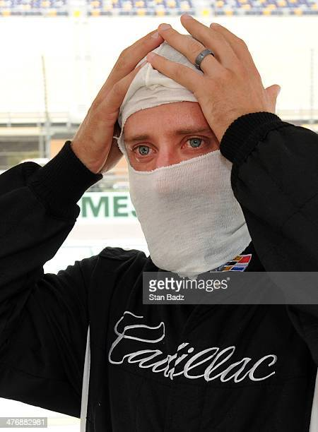 Graham DeLaet of Canada suits up during the Cadillac VSeries Challenge driving experience at the HomesteadMiami Speedway for the World Golf...
