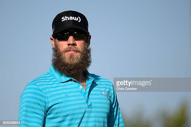 Graham DeLaet of Canada walks off the 13th green during the first round of the Sony Open in Hawaii at Waialae Country Club on January 14 2016 in...