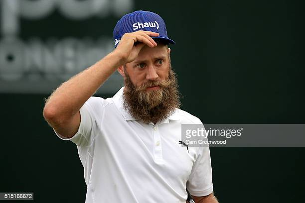 Graham DeLaet of Canada walks off the 18th green during the third round of the Valspar Championship at Innisbrook Resort Copperhead Course on March...