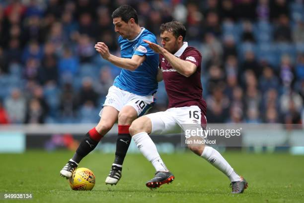 Graham Dorrans of Rangers vies with Connor Randall of Heart of Midlothian during the Ladbrokes Scottish Premiership match between Rangers and Hearts...