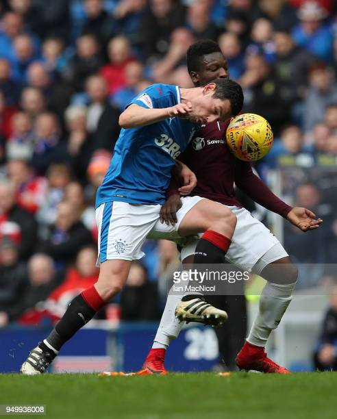 Graham Dorrans of Rangers vies with Danny Amankwaa of Heart of Midlothian during the Ladbrokes Scottish Premiership match between Rangers and Hearts...