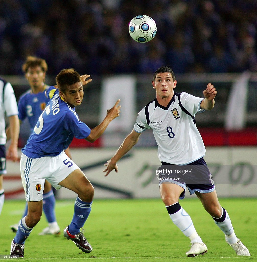 Graham Dorrans of Scotland and Junichi Inamoto of Japan compete for the ball during Kirin Challenge Cup 2009 match between Japan and Scotland at Nissan Stadium on October 10, 2009 in Yokohama, Japan.