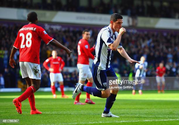 Graham Dorrans of West Brom celebrates scoring the second goal during the Barclays Premier League match between West Bromwich Albion and Cardiff City...