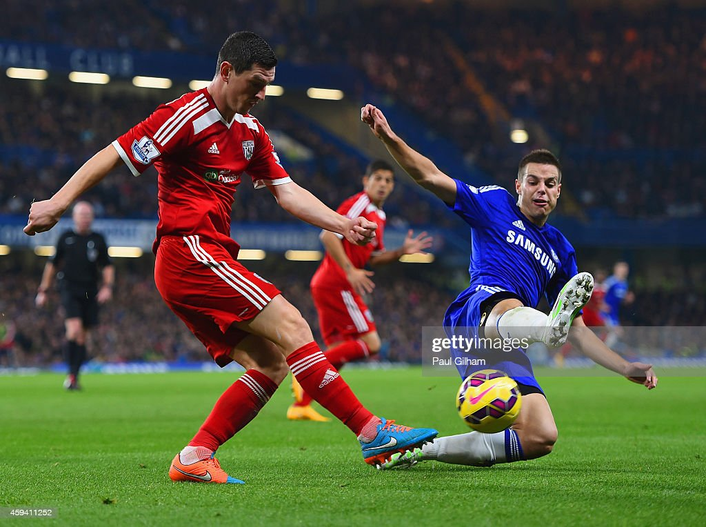Graham Dorrans of West Brom is challenged by Cesar Azpilicueta of Chelsea during the Barclays Premier League match between Chelsea and West Bromwich Albion at Stamford Bridge on November 22, 2014 in London, England.