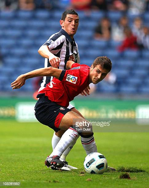 Graham Dorrans of West Bromwich Albion and Oier of Osasuna battle for the ball during the pre season friendly match between West Bromwich Albion and...