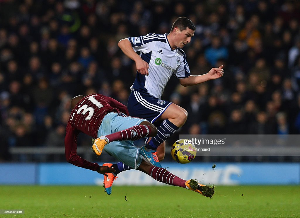 Graham Dorrans of West Bromwich Albion challenges Enner Valencia of West Ham United during the Barclays Premier League match between West Bromwich Albion and West Ham United at The Hawthorns on December 2, 2014 in West Bromwich, England.
