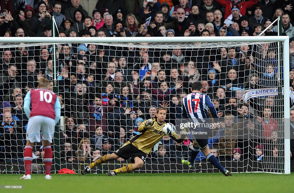 Graham Dorrans of West Bromwich Albion scores a penalty kick past Jussi Jaaskelainen of West Ham United during the Barclays Premier League match between West Ham United and West Bromwich Albion at the Boleyn Ground on March 30, 2013 in London, England.
