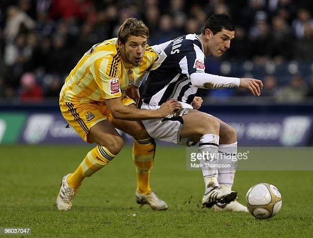 Graham Dorrans of West Bromwich Albion tangles with Alan Smith of Newcastle United during the FA Cup sponsored by EON 4th Round match between West...