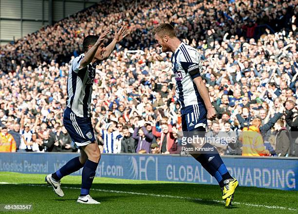 Graham Dorrans of West Bromwich congratulates teammate Chris Brunt of West Bromwich after he scores his team's second goal during the Barclays...
