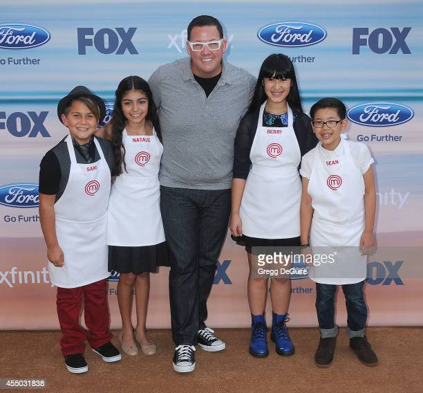 Graham Elliot with Masterchef Junior contestants Sam Natalie Berry and Sean arrive at the 2014 FOX Fall EcoCasino Party at The Bungalow on September...
