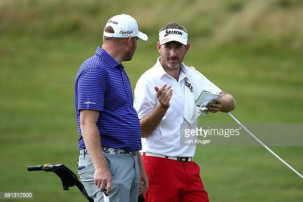 Graham Fox of Clydeway Golf and partner Gareth Wright of West Linton GC chats during day one of the PGA Fourball Championship at Carden Park on...