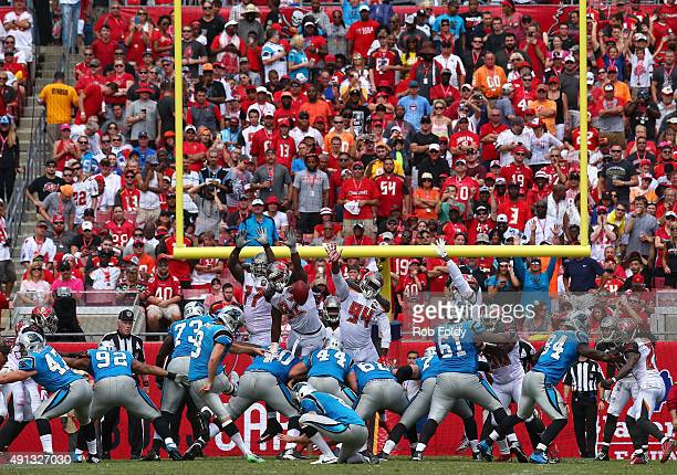 Graham Gano of the Carolina Panthers kicks an extra point during the third quarter of the game against the Tampa Bay Buccaneers at Raymond James...