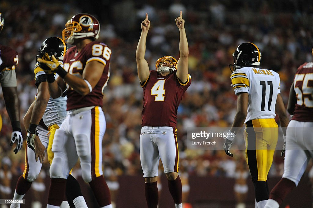 Graham Gano #4 of the Washington Redskins celebrates a successful field goal against the Pittsburgh Steelers at FedExField on August 12, 2011 in Landover, Maryland. The Redskins defeated the Steelers 16-7.