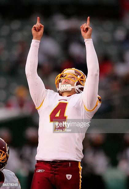 Graham Gano of the Washington Redskins celebrates after making a field goal against the Oakland Raiders at OaklandAlameda County Coliseum on December...