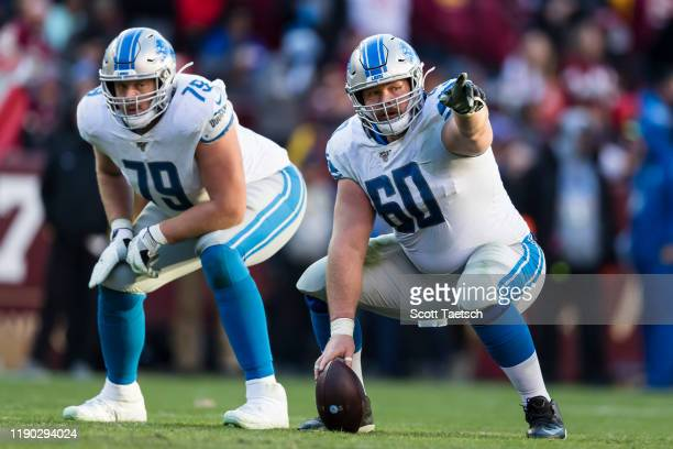 Graham Glasgow and Kenny Wiggins of the Detroit Lions line up against the Washington Redskins during the second half at FedExField on November 24...