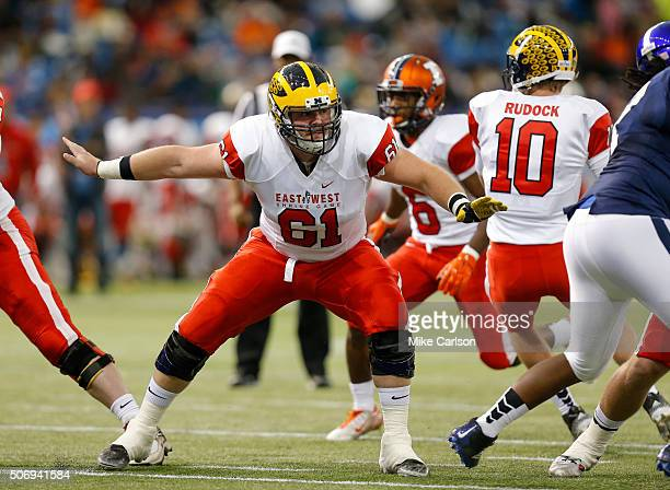 Graham Glasgow from Michigan playing on the East Team blocks during the first half of the East West Shrine Game at Tropicana Field on January 23 2016...