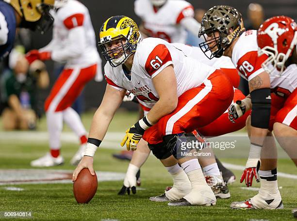 Graham Glasgow from Michigan playing on the East Team looks to snap during the first half of the East West Shrine Game at Tropicana Field on January...