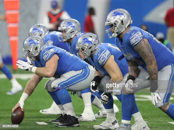 Graham Glasgow of the Detroit Lions gets ready to snap the ball during the second quarter of the game against the Green Bay Packers at Ford Field on...