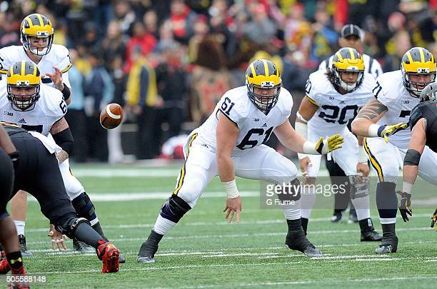 Graham Glasgow of the Michigan Wolverines snaps the ball against the Maryland Terrapins at Byrd Stadium on October 3 2015 in College Park Maryland