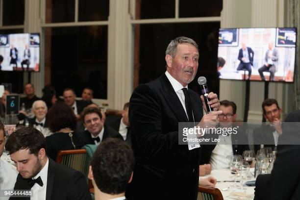 Graham Gooch is asked questions by Mark Nicholas during the PCA Long Room Dinner at Lord's Cricket Ground on April 12 2018 in London England
