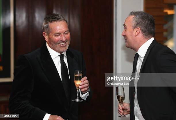 Graham Gooch laughs with a friend during the PCA Long Room Dinner at Lord's Cricket Ground on April 12, 2018 in London, England.