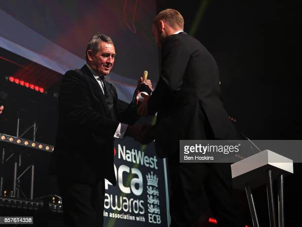 Graham Gooch presents Mark Stoneman of Surrey with an award for The PCA Team of the Year during the NatWest PCA Awards at The Roundhouse on October...
