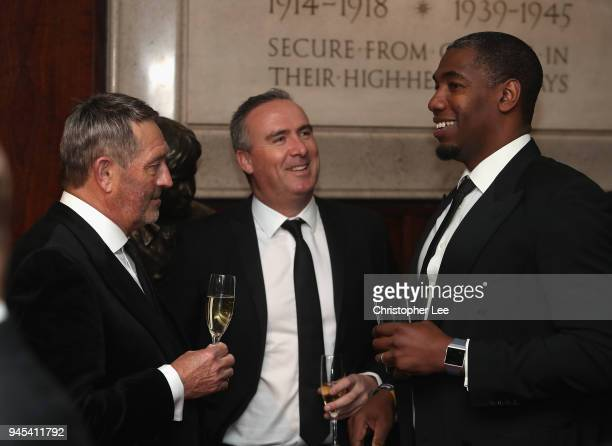 Graham Gooch talks to Alex Tudor during the PCA Long Room Dinner at Lord's Cricket Ground on April 12, 2018 in London, England.